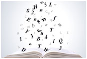 Image of open book with letters exploding upwards