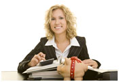 Image of woman at desk using calculator